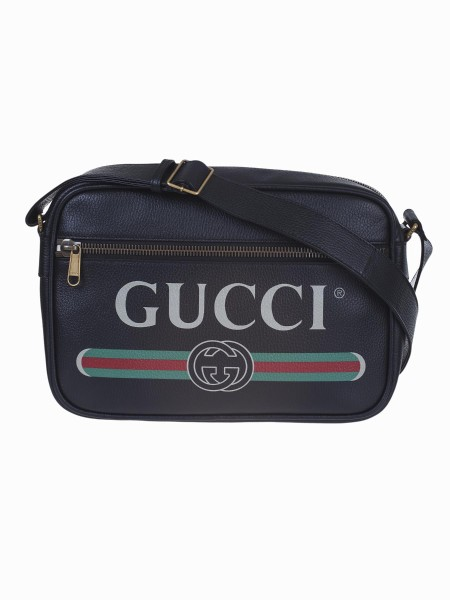 "Shop GUCCI  Borsa: Gucci Black leather with Gucci vintage logo crossbody bag. Brass hardware. Front zipper pocket. Interior zipper pocket and two smartphone pockets. Adjustable leather strap with 19.5"" drop. Top zipper closure. Dimensions: Length 33.5 cm, Height 23.5 cm, Depth 9.5 cm. Cotton and linen lining. Made in Italy.. 523589 0QRAT-8163"